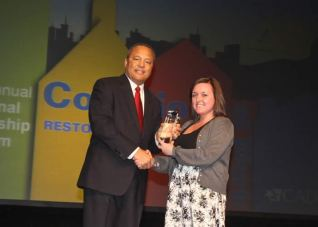 """Allana Chittick receives the """"Outstanding Youth Leadership Award"""" for her work with P2D2"""